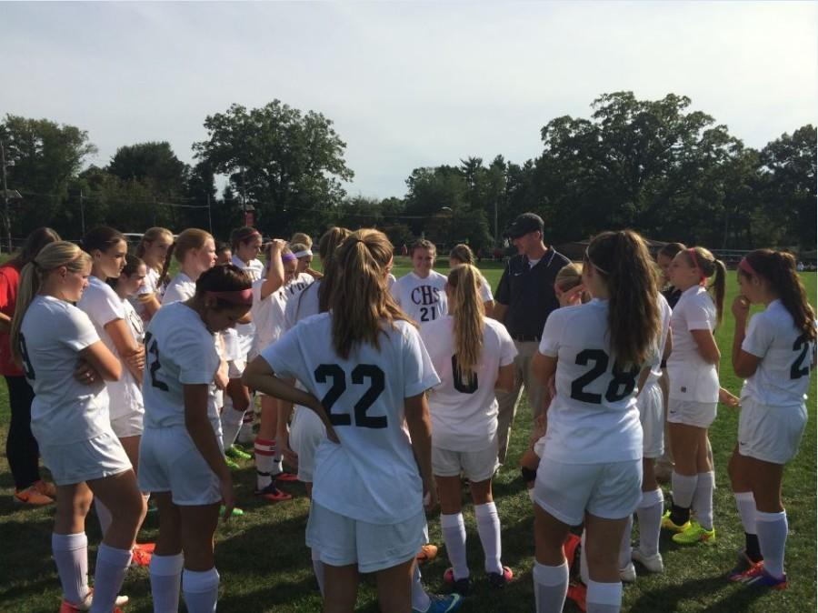 Digney gives a pep talk to the girls before their game.