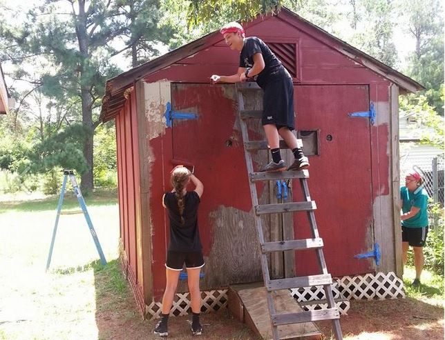 (l-r) Seniors Sydney Zarrilli and Wyatt Holl spent the day painting a shed.