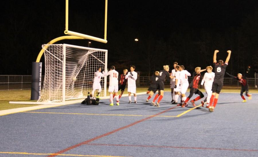 Cinnaminson Players Celebrate After the Game-Tying Goal Goes Into the Net WhileGovernor Livingston Dejectedly Reacts to the Game-Changing Moment