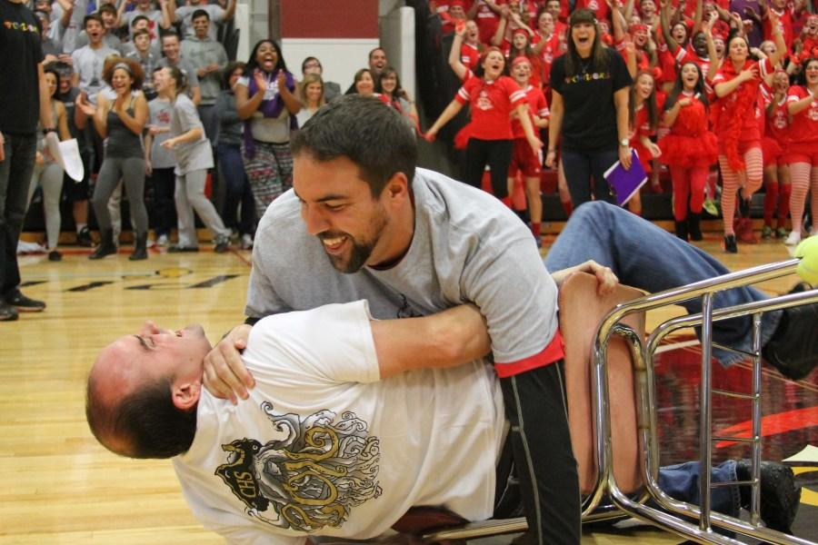 Students and faculty show their surprised expressions as freshman representative Dan Rella battles junior representative Mike Beirao for his chair in musical chairs.