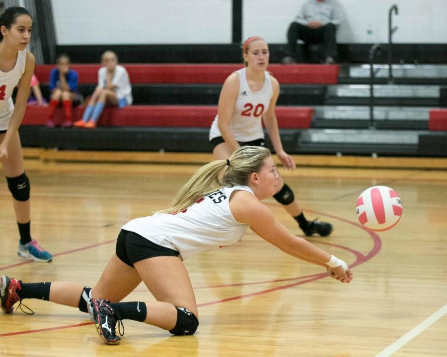 Senior Mariah Wood digs the ball.