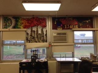 (L) Lee Colins and (R) Eva Rodriguez's senior projects are on the back wall.