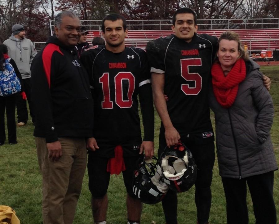 Nick+%2810%29+and+Dylan+%285%29+Thevanayagam+pose+with+their+parents+after+a+35-0+win+against+Delran+on+Thanksgiving.