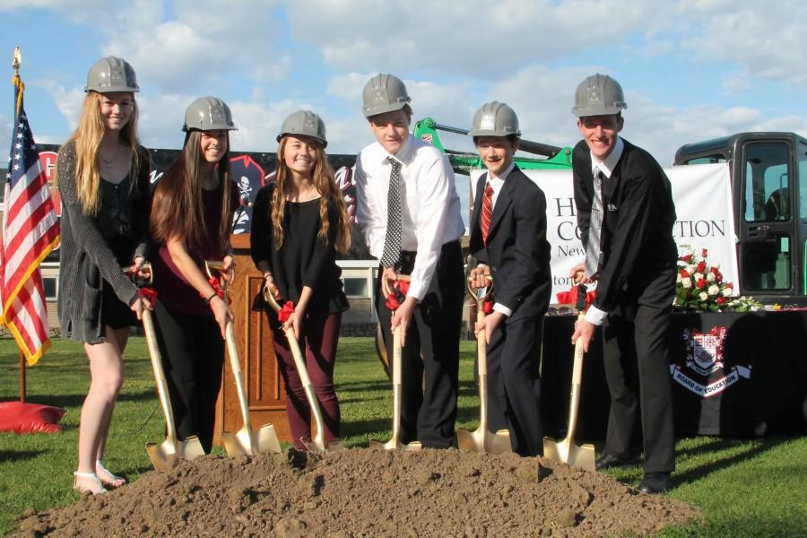 Sophomore Class President Anne O'Malley, Junior Class President Anna Saginario, Senior Class President Sydney Zarrilli, Freshman Class President Larry Michalski, 8th Grade Class President Tim Clements and Student Council President Dom Gigliotti pose for a picture while breaking ground on the gym.