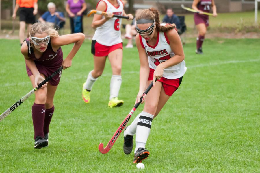 Nicole Teague dribbles the ball down the field against Holy Cross for CHS.