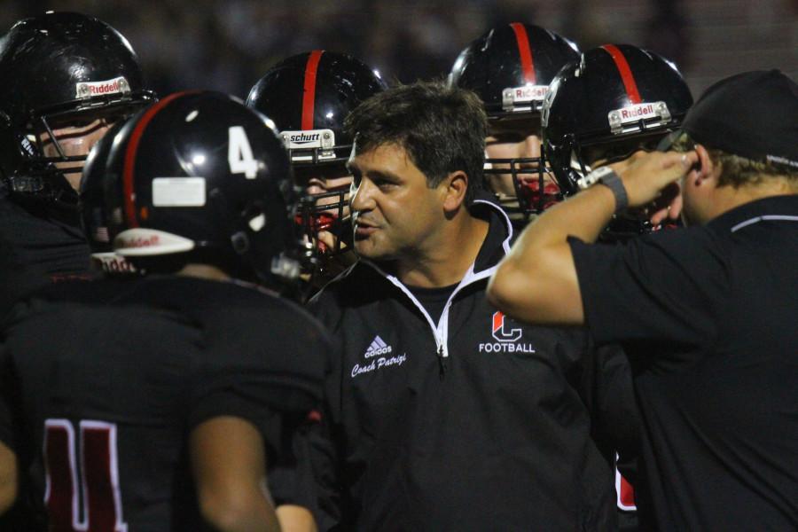 Coach Mario Patrizi addresses his team during a 2015 game.