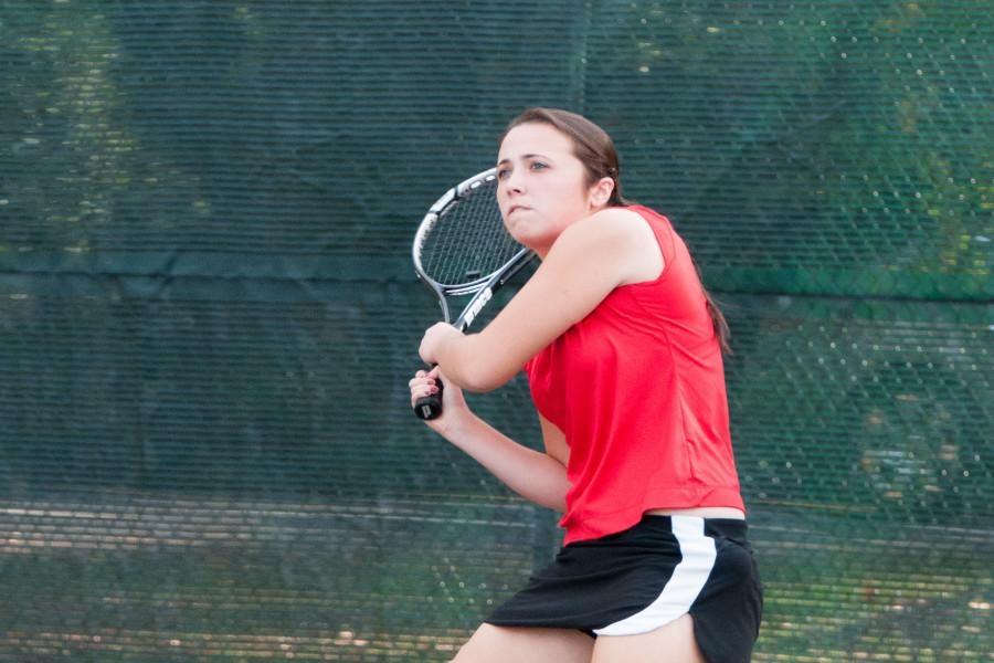 Senior Jenna Cucinotta returns a shot during a match this year.