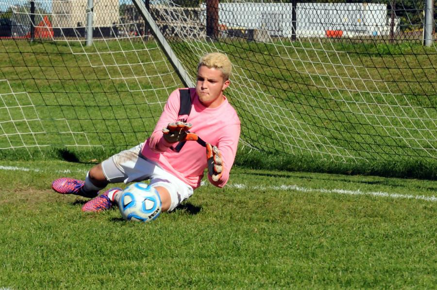 Junior Goalie Mike Deal saves a ball in pre-game warm-ups earlier in the season