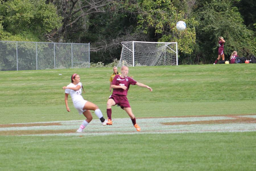 Senior Anna Saginario looks to play the ball for CHS during its 3-2 win versus Holy Cross on Sept. 26.