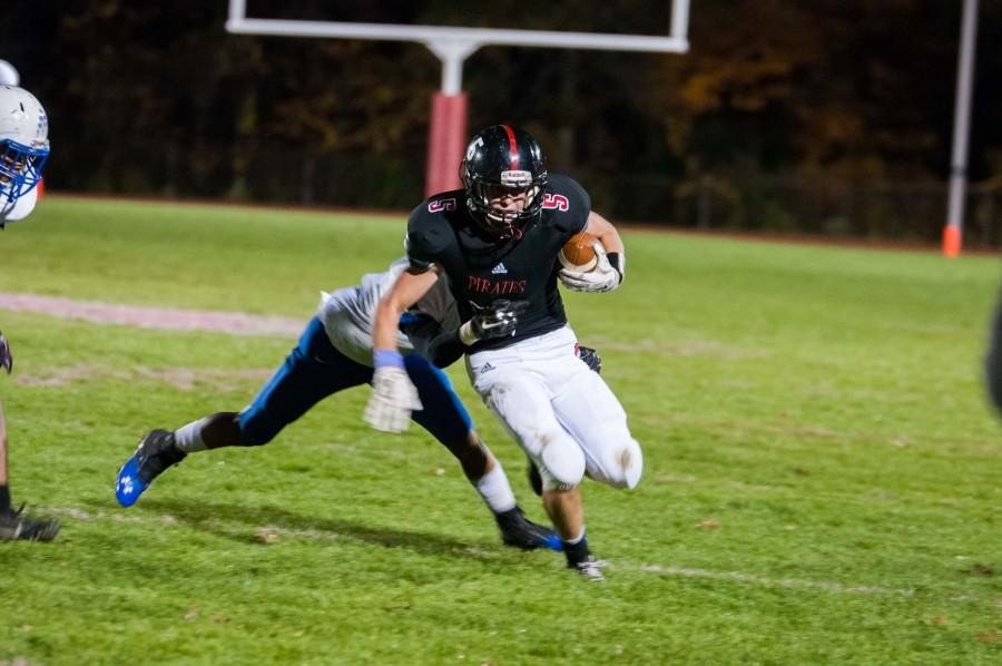 Junior receiver Frank Stepnowski breaks away from a Burlington City defender in the Oct. 30 game for the Pirates