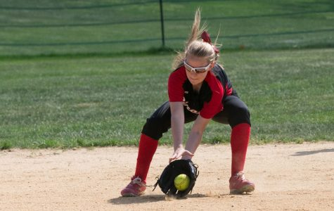Junior Tori Robinson  fields a ground ball at shortstop.