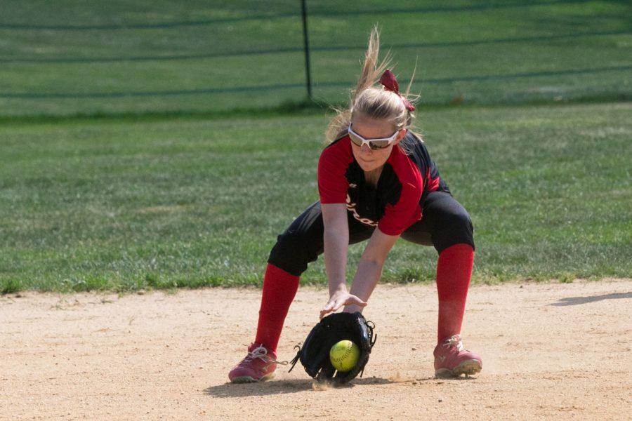 Junior Tori Robinson  fields a ground ball at shortstop.