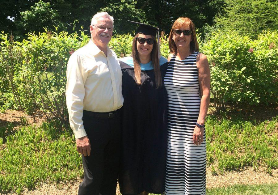 Miss Arni (center) is pictured with her partents after her graduation from Rowan University.