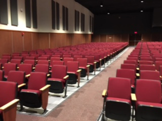 A view of the new auditorium shows that the aisles were removed next to the wall, so only the aisle between the three sections remain