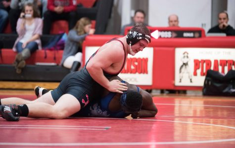 Senior Keith Swartley stuffs an opponent's head in a match last season.