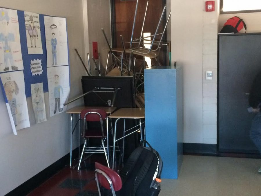 Mr. Lombardo's class used a lot of classroom objects to barricade their door.