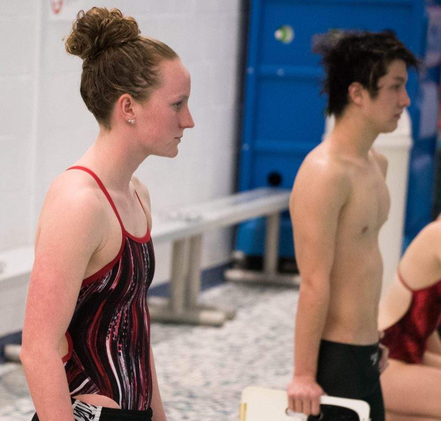 Black (left) cheers on her team at a meet last winter.