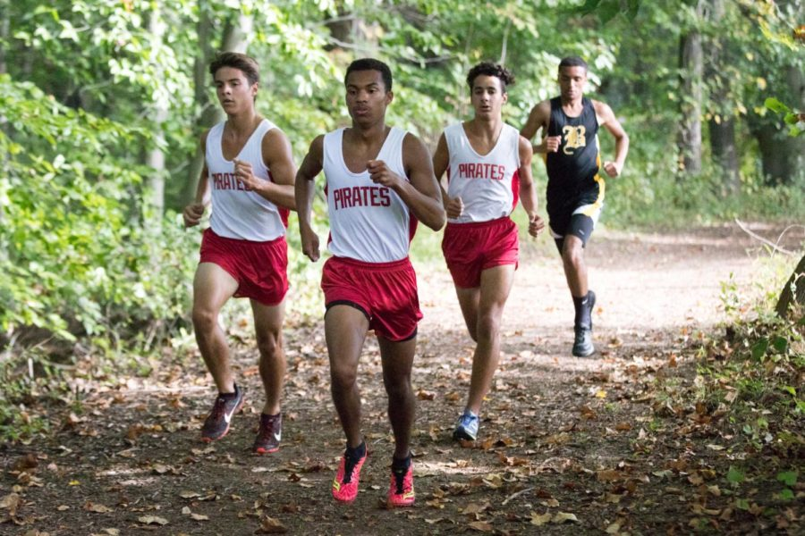 Much like they did all season, the boys were lead in this race by senior Justin Arnold (center); senior Max Adams (left) and sophomore Austin Gabay (right)
