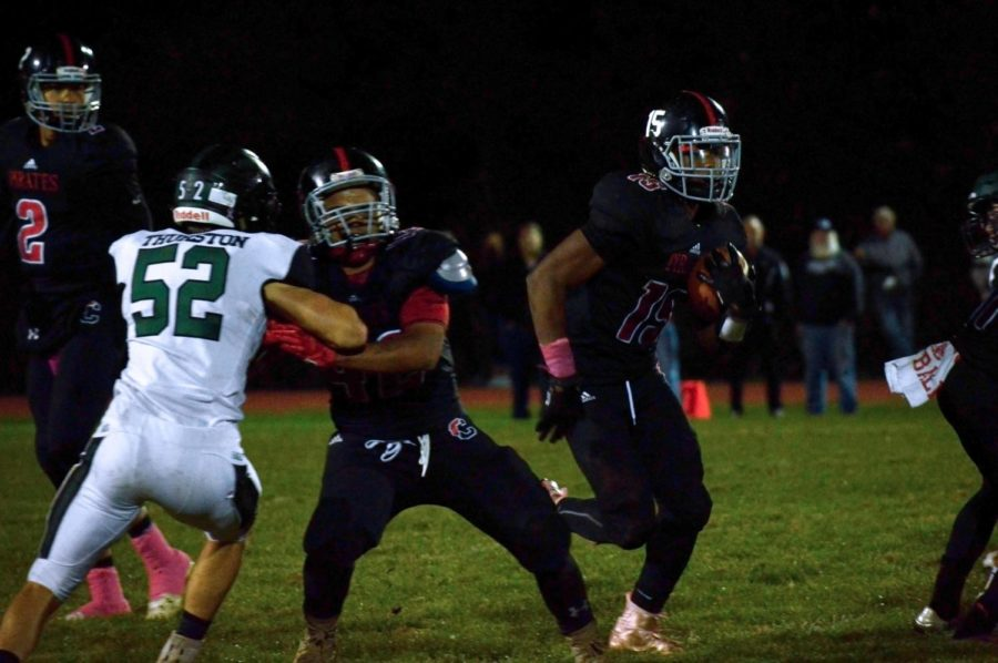 Junior Rashad Raymond explodes through the middle of the line against West Deptford on Homecoming Night.