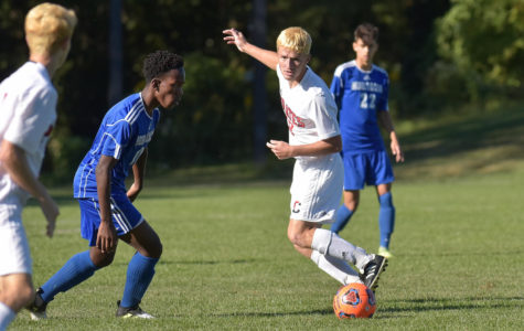 Junior Shane Spence plays a ball at midfield against Northern Burlington in the Cinnaminson 1-1 tie on October 2.