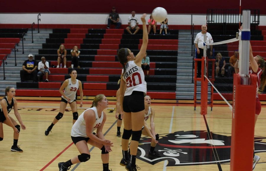 Sophomore Maddy Thompson (#00) slams the ball while senior Rebecca Martino (#16), junior Brooke Painter (#17), freshman Kaitlyn Mulligan (#23) and sophomore Sierra Harris (#7) watch the play.