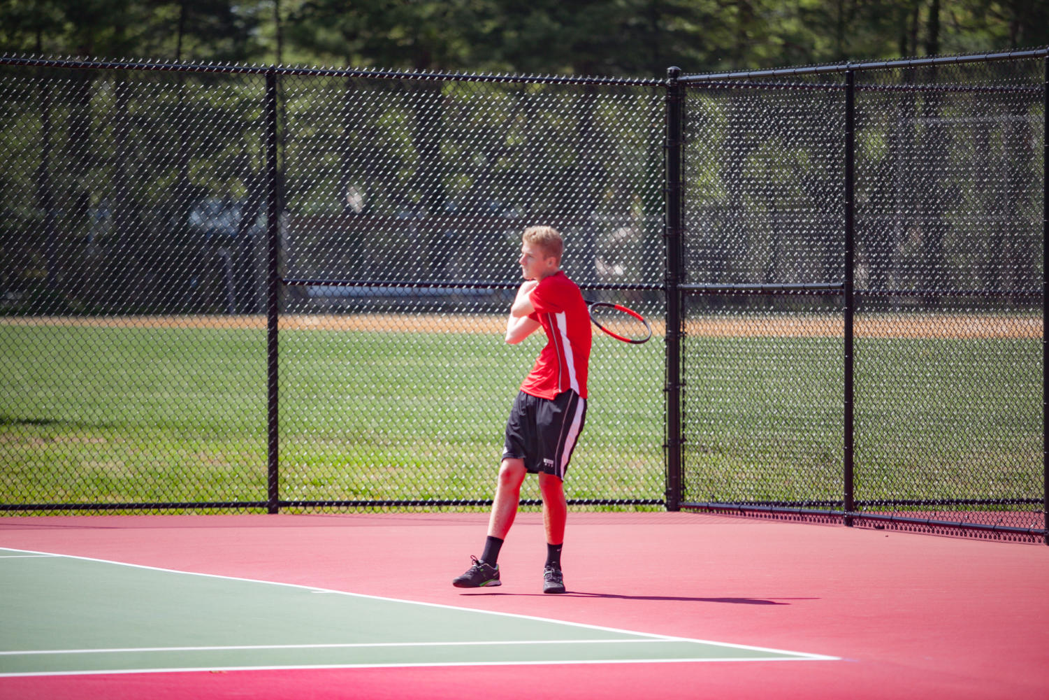 Senior Ronnie Runquist hits the ball.