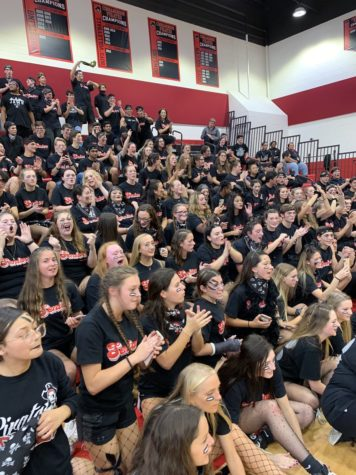 The senior class cheers on their classmates during the pep rally