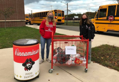 Freshman Sam Keeports and Junior Grace Coller, the students leaders of the CHS Food Pantry, collect food at a Pirates home football game.