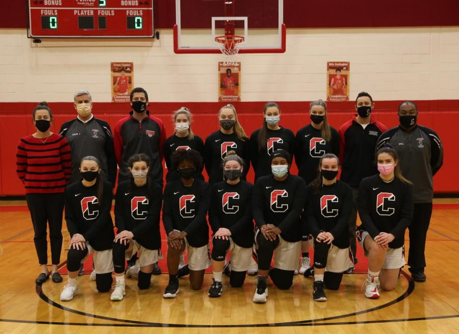 The varsity girl's basketball team poses with the coaches for a team picture. Photo courtesy of Lors Photography.
