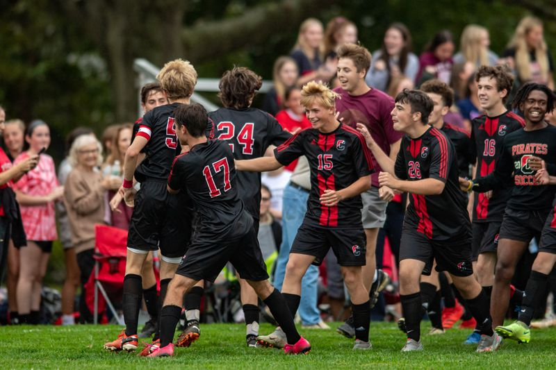 The boys celebrate after their victory over rival Delran bears. (Photo courtesy of nj.com)